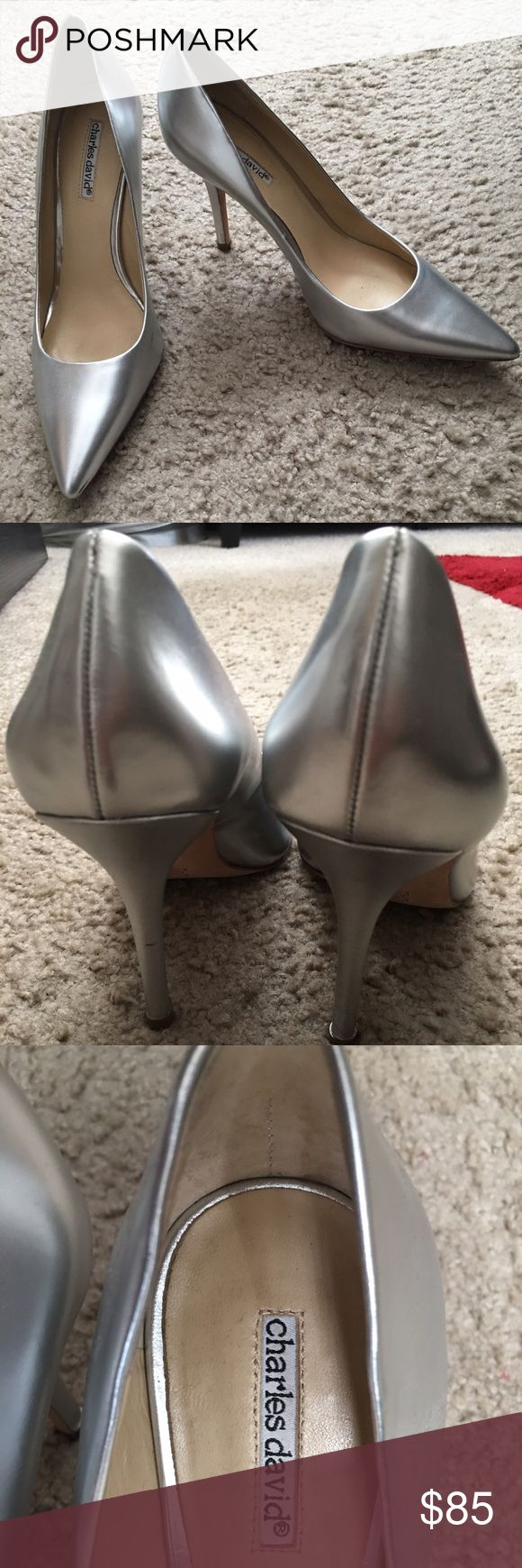 Silver Leather Charles David Pump Comfy silver metallic Charles David pump!! The shoe is very comfy ! Small wrinkle on heel where it was repaired. Great look!! Charles David Shoes Heels