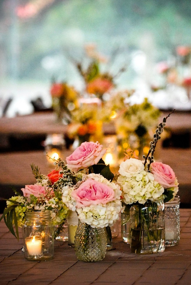Small vases with floral groupings centerpieces decor
