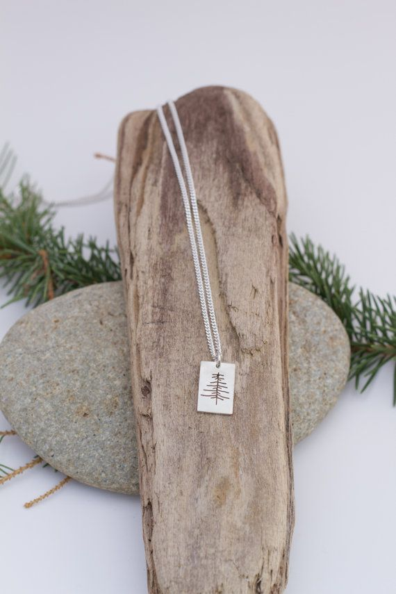 The clearest way into the universe is through a forest wilderness. -John Muir  Are you the kind of girl who sticks to one necklace and never takes it off? Well then look no further! You just stumbled across your new favourite piece. Thanks to its small and lightweight quality, this handmade silver tree necklace will be your perfect go to for years to come.  Each necklace boasts a one of a kind tree, just as they are in nature. The tree is marked for eternity with a jewellers saw, sanded and…