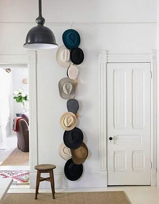 cowboy hat collection on the wall / patio?
