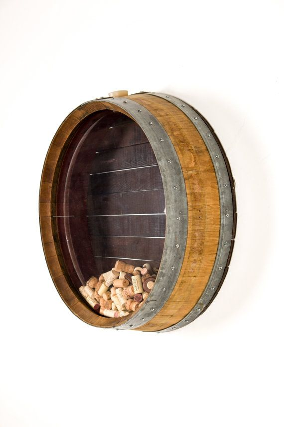 Have a cork collection and need an amazing way to store it?  We take a retired Napa wine barrel and screw it together before sanding and sealing it with 3 coats of clear UV sealer. Then we replace the barrel head with a custom front out of clear Plexiglas (strong and kid friendly!). The back is made from our large wine tank wood and matches perfectly.  To put corks inside, simply remove the bung from the top and drop it inside. There is a small hinged door on the backside for easy cork…
