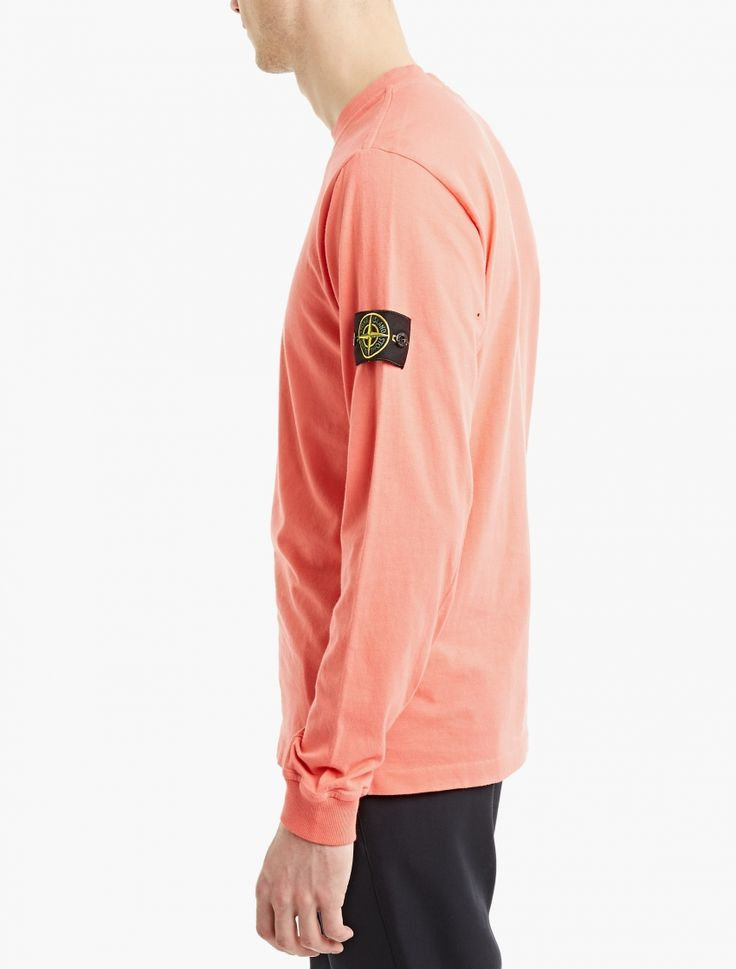 The Stone Island Long-Sleeved Cotton T-Shirt for SS17, seen here in fuchsia.  This long-sleeved t-shirt from Stone Island is crafted from premium cotton and cut to offer a relaxed fit. It is finished with a reinforced crew-neck, eyelets to the underarms for ventilation and the brand's logo to the chest.