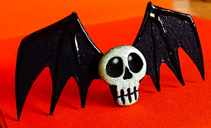 Batty Skull pin - handmade wearable art that glows in the dark! Polymer clay skull on stiff wings. A fashion statement if ever! by Ellie Gee ***MacabreWebs Studios*** 2016