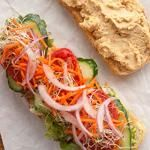 Lemony Hummus Sandwich with Cucumber, Radish Sprouts, and Red Onion