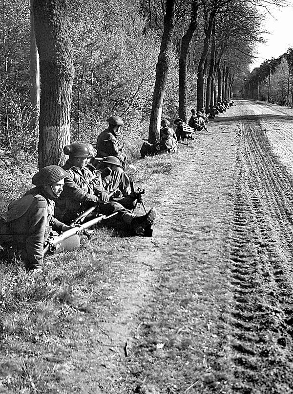 Canadians in Germany - Infantrymen of The Royal Regiment of Canada resting near Dingstede, Germany, 25 April 1945 April 25, 1945 , Place of publication: Dingstede, Germany (vicinity)