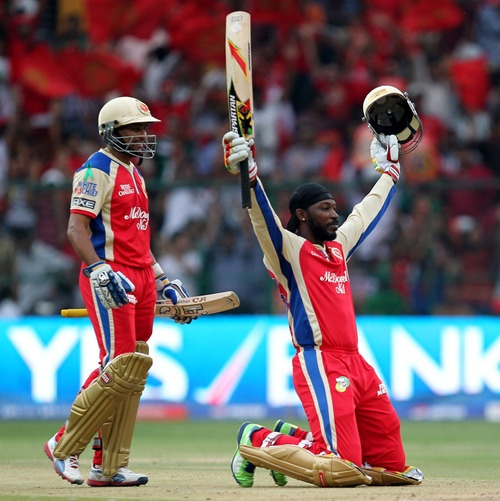 Chris Gayle celebrates his 30-ball hundred. He went on to make 175 n.o. off a mere 66 balls (April 23, 2013)