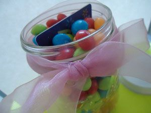 gift-card-wrapped-in-a-jar filled w/candy! You can also do this putting cash in the middle.