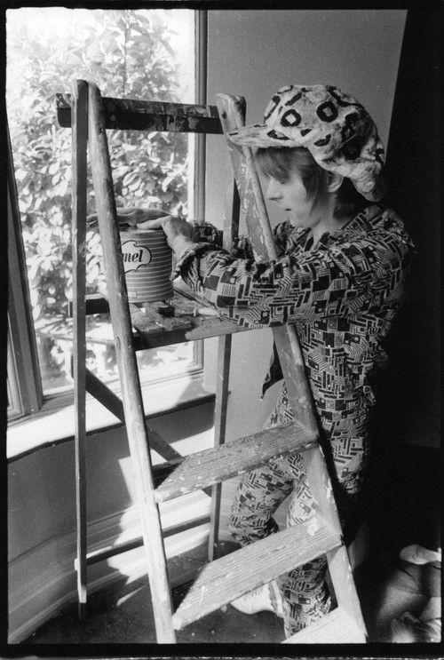 David Bowie painting his house, photographed by Michael Putland, 1972