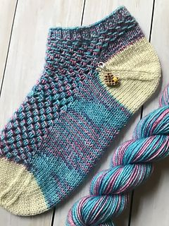 Magic tricks are fun and engaging, just like this shortie sock pattern! And a magician's best trick is keeping you guessing 'how did they do it?' This fun lace design is worked over an easy to memorize 4-row repeat that may seem complicated, but really isn't, and will result in a fast knit that is sure to impress.
