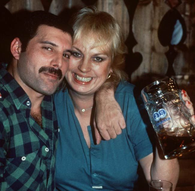 Freddie Mercury and Barbara Valentin poses in a bar...