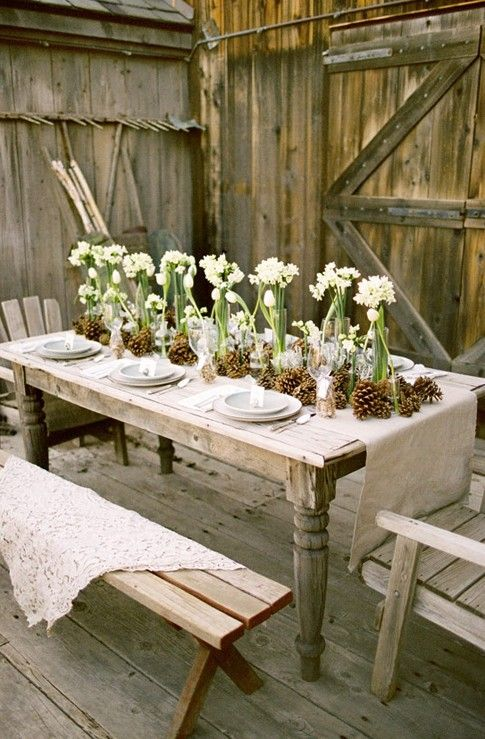 rustic farm wedding table setting with burlap, lace, pine cones, neutral colors