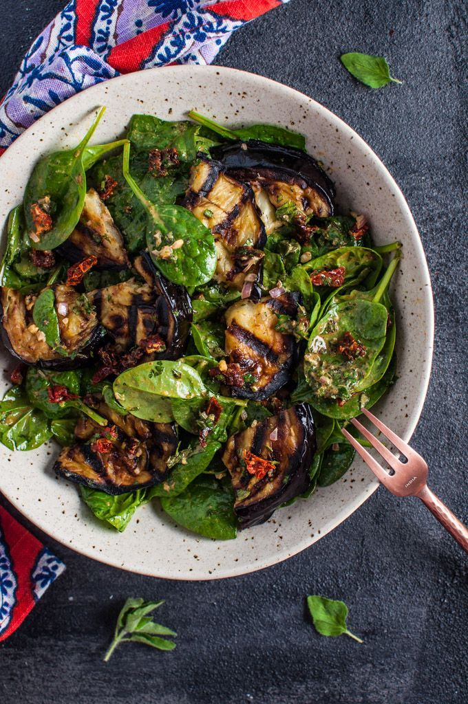 This grilled eggplant and spinach salad makes a wonderfully fresh, healthy, and filling warm weather meal. The eggplant is smoky and delicious, and the smoked paprika in the lemony dressing enhances its flavor even more | thanks to Salt & Lavender