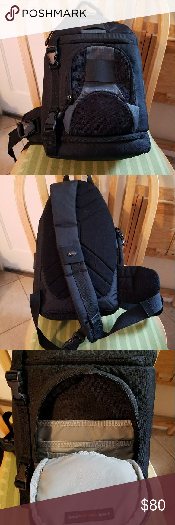 Lowepro sling backpack Good used condition, only a tiny snag on lower front, reflected on last picture. Tons of space for memory cards, film, lenses and multiple cameras. All velcro, zippers and closures in working order. Lowepro Bags Backpacks
