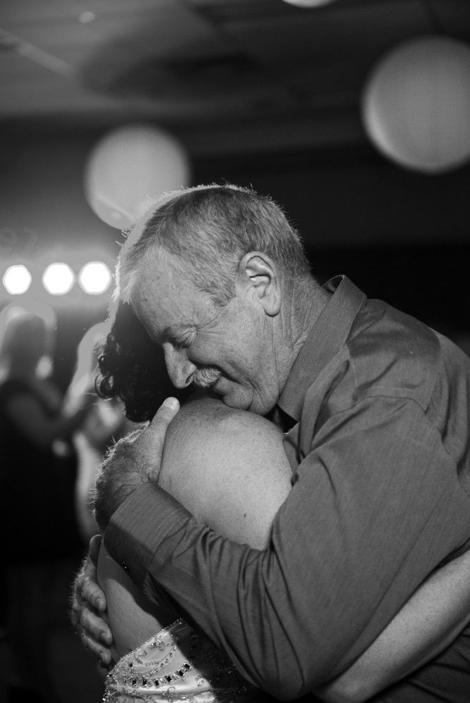 Proud dad during the father daughter dance on her wedding day.