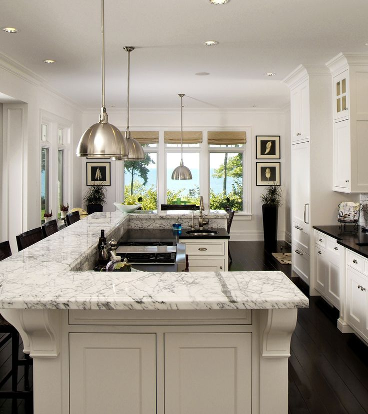 Love the design of this island bi level u shaped island - Kitchen island with cooktop and prep sink ...