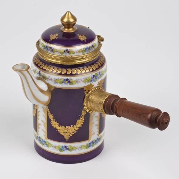 By the late 18th century, the Sevres manufactory was producing chocolatieres for French royalty and aristocrats, including Madame de Pompadour.