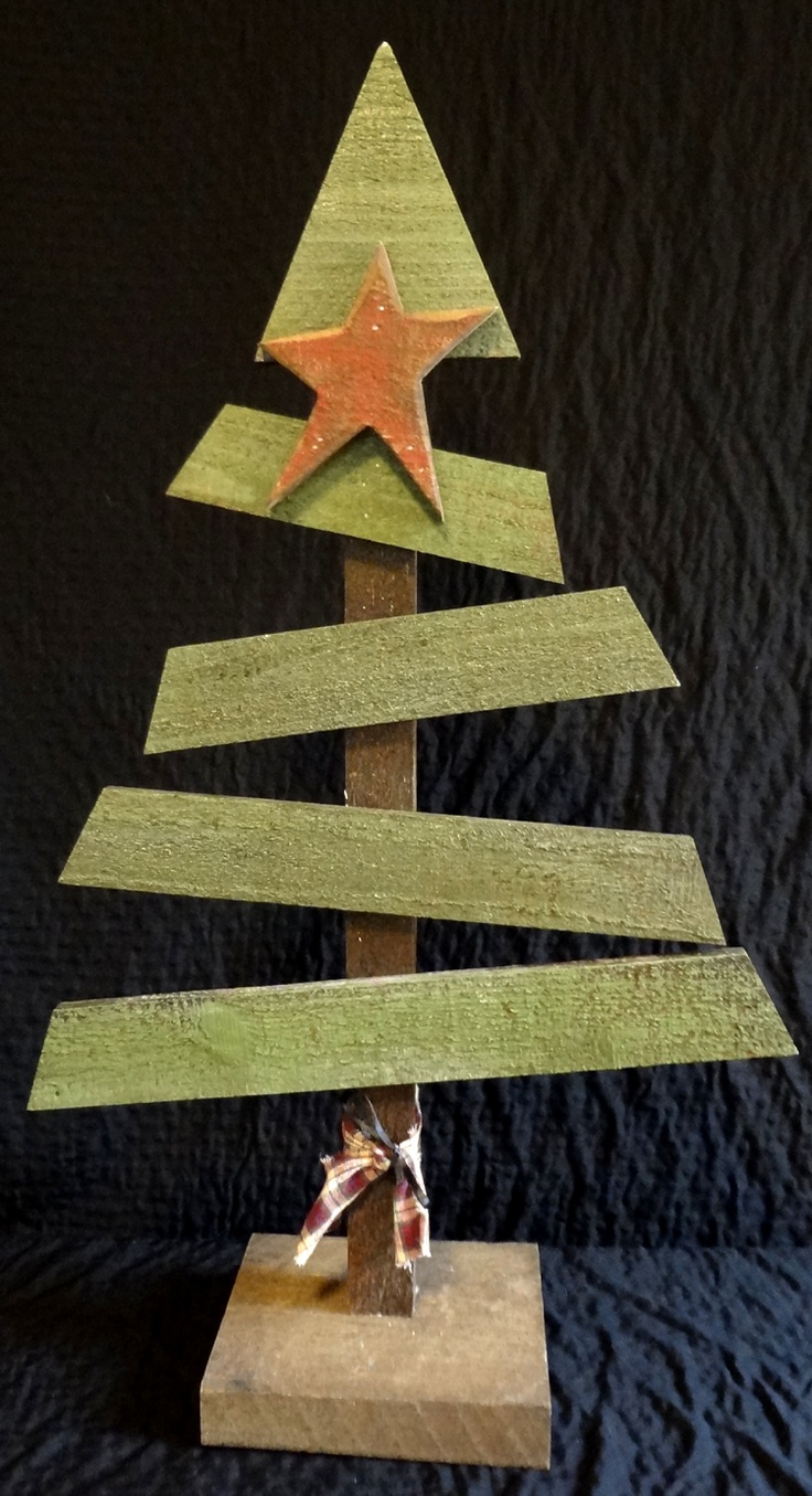 A cute hand-crafted wooden tree all ready to assist with your holiday decorating