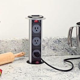 A hidden power outlet will make your kitchen look very organized and clean.