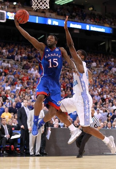 ST LOUIS, MO - MARCH 25:  Elijah Johnson #15 of the Kansas Jayhawks drives for a shot attempt in the first half against Harrison Barnes #40 of the North Carolina Tar Heels during the 2012 NCAA Men's Basketball Midwest Regional Final at Edward Jones Dome on March 25, 2012 in St Louis, Missouri.  (Photo by Andy Lyons/Getty Images)