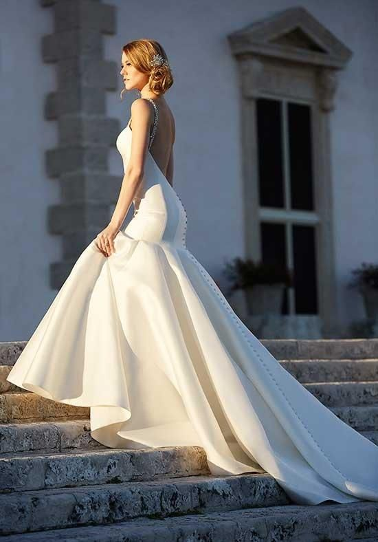 An impressive 600 hemline, fabric -covered buttons, and Swarovski crystal straps complete the dramatic, high-fashion look of this modern fit-and-flare bridal gown | Martina Liana | https://www.theknot.com/fashion/735-martina-liana-wedding-dress