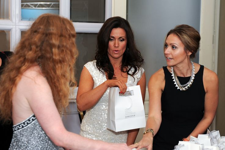 Susanna Reid grabs her goody bag as she enjoys looking at the   fabulous SBC range on our stand