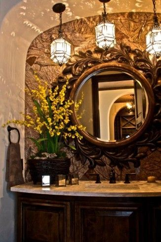 Beautiful mirror and amazing pendant lighting in this powder room.