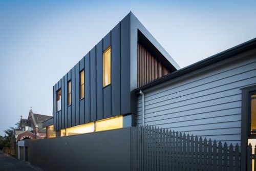 two-story house dark zinc standing seam cladding wall