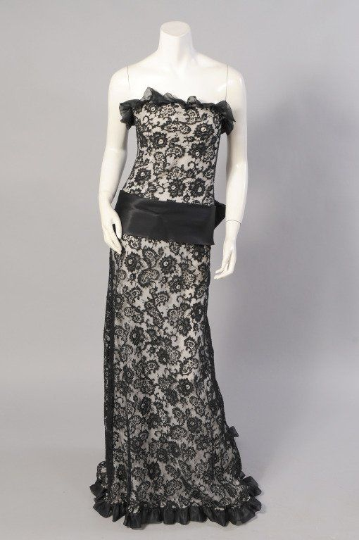 2b6e0502b90 Ultra feminine, this stunning black lace strapless evening gown was  designed by Yves Saint Laurent for a 1970's Haute Couture collection.
