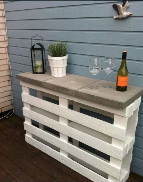 A couple of pallets and some paving slabs and voila - outdoor bar!