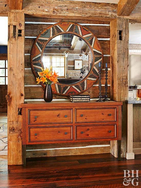 Rustic wood is a hallmark of Southwestern style -- and this entryway features various forms of the material. With a gorgeous sideboard and exposed beams overhead, this room is all about reclaimed wood. A wood-framed circular mirror adds a hint of pretty pattern.