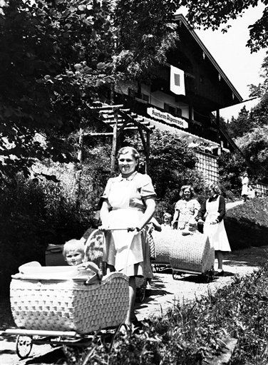 Staff members, mothers and children in a Lebensborn home.