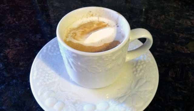 Spiced Pumpkin Latte-A spicy and delicious pumpkin latte made with real food, dairy free ingredients from WellnessMama.com #latte #pumpkin #wellness