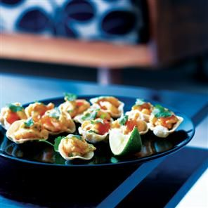 Mini poppadums with spiced prawns and mango chutney