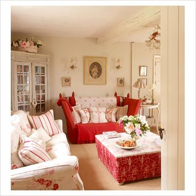 romantic living room.  Love the reds.