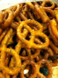 Seasoned pretzels (ranch). Alternate recipe- 2# pretzels, 12oz bottle Orville Redenbocker butter popcorn oil, 2T dill weed, 1tsp onion powder,1tsp garlic powder, 1 pkg Good Seasons Italian dressing mix. Stir every 30 min for 3 hours...addictive!