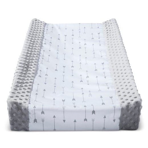 Sail through clothing and diaper changes without worrying about messes. This Wipeable Changing Pad Cover from Cloud Island™ makes cleanup quick and easy, so you can focus on what really matters. You'll love the neutral gray color and a fun arrow pattern that goes with nearly any nursery decor. Baby will love the feel of the plush, textured sides. <br><br>We made it better so you can feel better.<br>This product is STANDARD 100 by OEKO-TEX® certified, me...