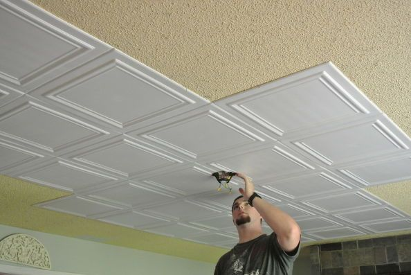 """Good Bye Popcorn Ceiling. Easy and relatively inexpensive way to cover up popcorn ceiling. No mess no scraping. Just glue up (we used cheap caulk for the adhesive) These ultra lite tiles made of recycled Styrofoam are easy to cut and can be painted"""