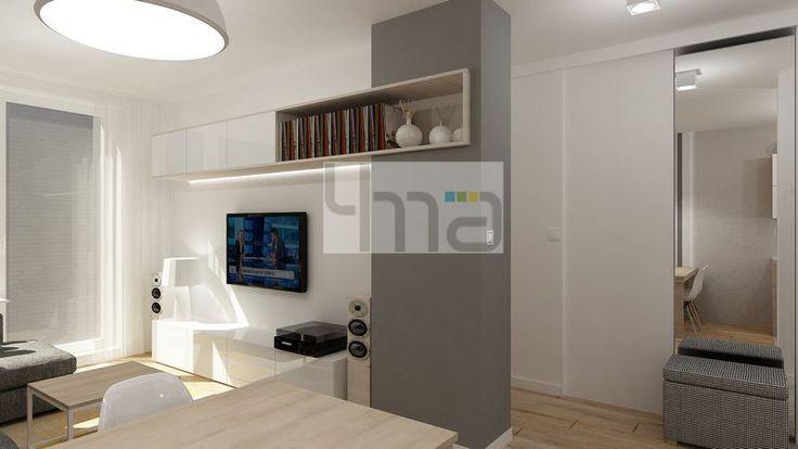 Dwupokojowe mieszkanie 48 m2 zaprojektowane dla młodej pary - http://4ma-projekt.pl Biało-szara kolorystyka z elementami jasnego drewna. Salon.