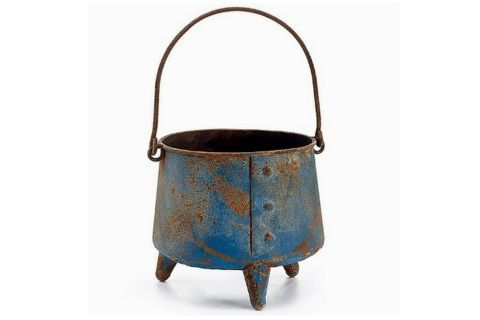 "Perfect planter!  A rustic reproduction antique metal cauldron, distressed blue with wonderful rust accents, makes an unusual planter or home decor item. Piece has three metal legs and handle as well - nicely done primitive inspired piece!  measures 6 1/2""H x 6 1/4"" opening."