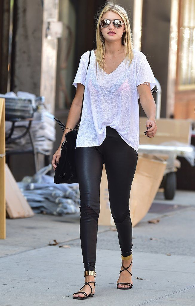 For a September day in the city, Gigi nailed the model-off-duty vibe in leather leggings and a loose white tee.