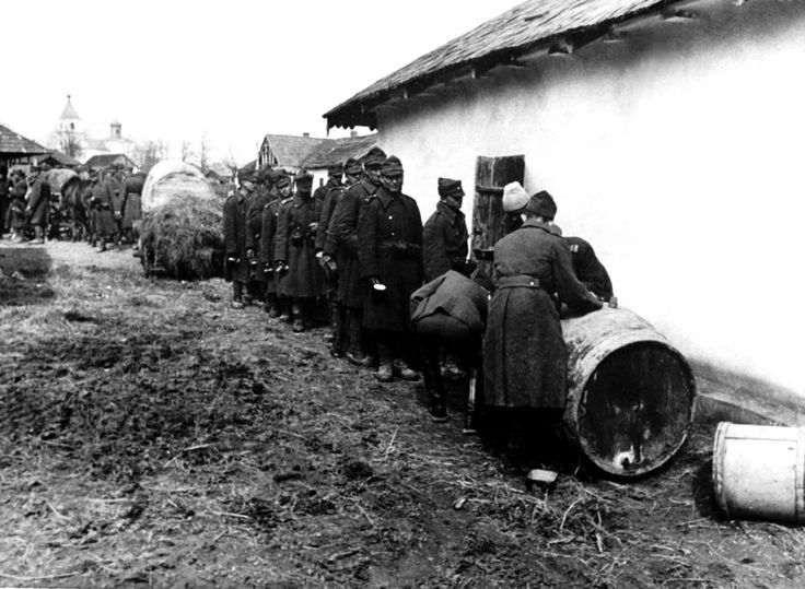 Romanian soldiers queue for a cup of wine in Transnistria during the Axis invasion of the Soviet Union. After occupying the region, Romania created the Transnistria Governorate, aRomanian administered territory. The region was retaken by the Soviets in early 1944. On 23 August 1944, a coup d'état led by Romanian King Michael ousted the pro-Axis government of Ion Antonescu and Romania switched sides in the war. Transnistria would become part of the Moldavian Soviet Socialist Republic, ...