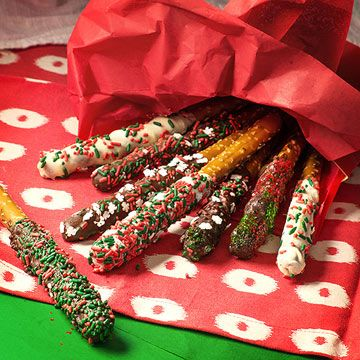Kids can help roll chocolate-dipped pretzel sticks in small Christmas candies or sprinkles!