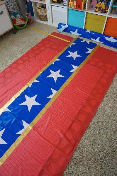 diy wonder woman table covers with supplies from shindigz