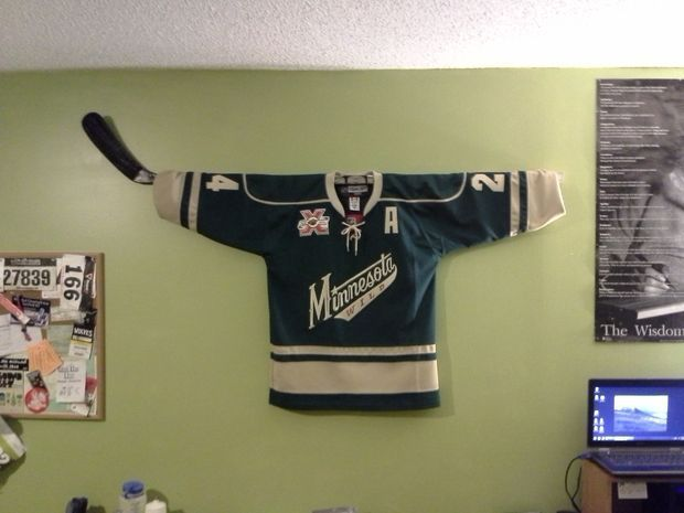 Hockey Stick Jersey Hanger -- Can I change that to a (Toews) Hawks jersey?