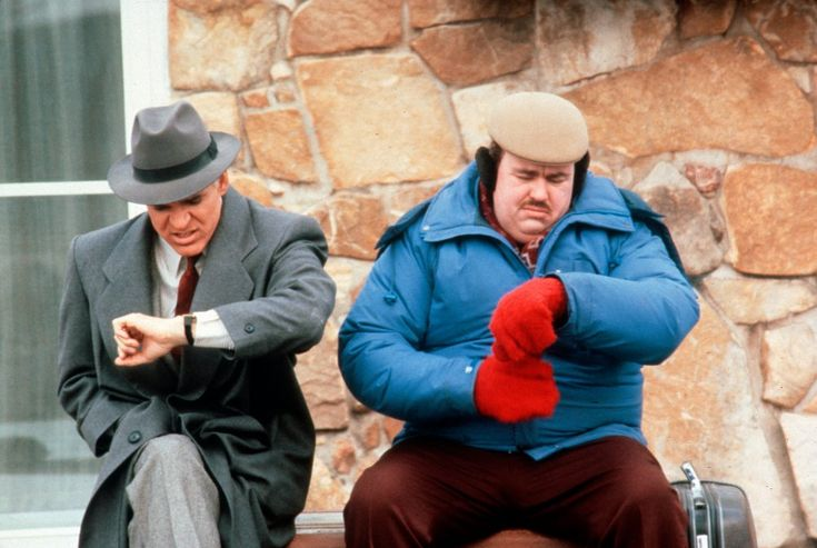 Compare and contrast two approaches to winter style in Planes, Trains and Automobiles (1987): Steve Martin's marketing executive clearly struggling to stay warm in grey suit and overcoat, while John Candy's brash curtain-ring salesman leaves nothing to chance in beret, ear muffs, bold red gloves and thickly-padded ski jacket.