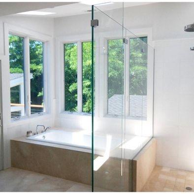 Double shower backing onto bath