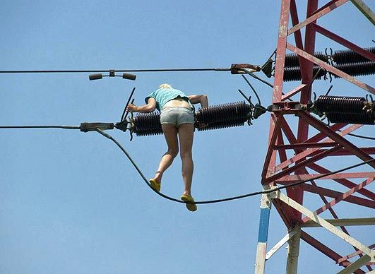 Skunk girl gets high and risks death by climbing electricity pylon