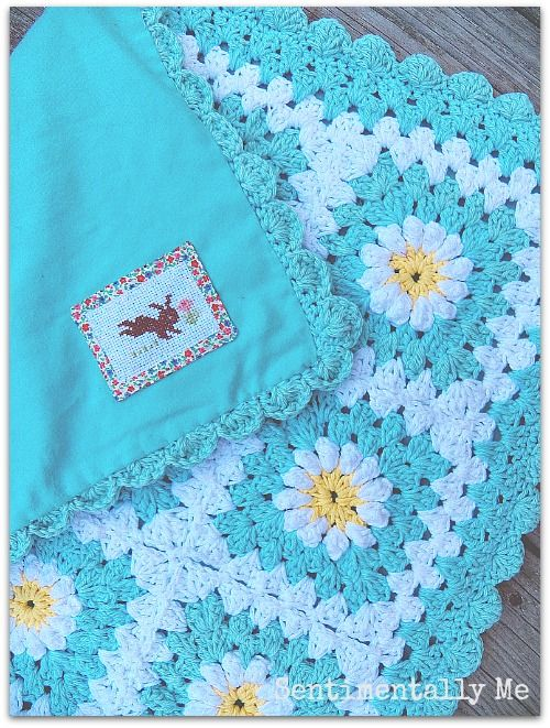 I love the idea of adding fabric to the back of a crocheted blanket for warmth :: Aqua Daisy Crochet Baby Blanket with fabric backing