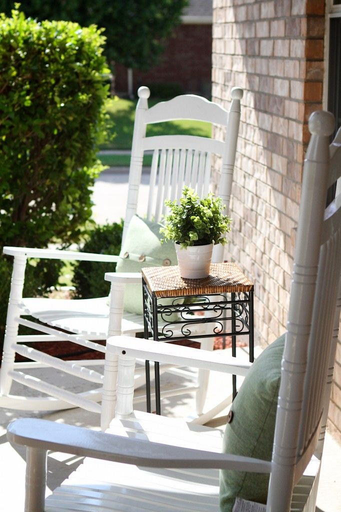 Front porch with white rocking chairs 12