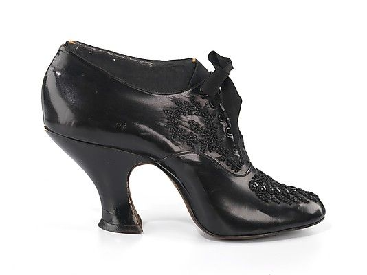 Black leather dinner shoes (oxfords) by Charles Strohbeck, Inc., American, 1900-1910.  The extremely exaggerated style and intact wooden form indicate that the shoe was probably an exhibition piece executed to show capabilities of the manufacturer, rather than a representative production sample.